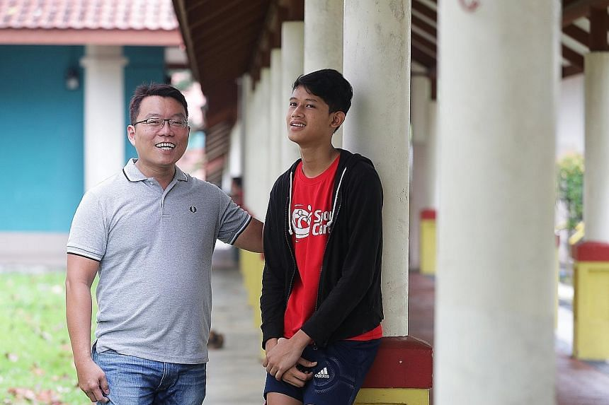 Mr Siow Peng Guan with 16-year-old Ali Imran Rosli, whom he mentors at charity Tasek Jurong's Beacon of Life Academy, at the block of flats in Taman Jurong where the teenager lives.