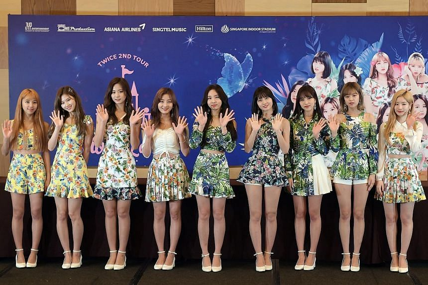 Members of the band Twice - comprising (from left) Chaeyoung, Sana, Tzuyu, Jihyo, Nayeon, Momo, Mina, Jeongyeon and Dahyun - say they are fans of Singapore's chilli and black pepper crab.