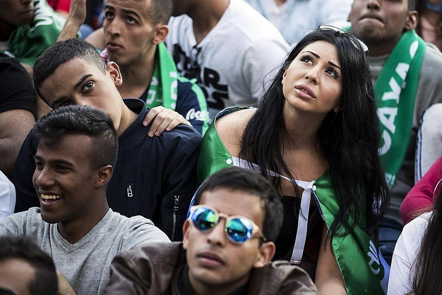 A woman enjoying her day out among the Saudi Arabia supporters as they watch the 2018 World Cup's opening match last Thursday between their team and hosts Russia in Moscow's Luzhniki Stadium.
