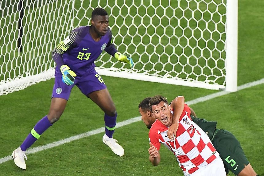Nigeria defender William Troost-Ekong (No. 5) getting too close for comfort with Croatia forward Mario Mandzukic for the referee's liking, leading to a penalty awarded from which Luka Modric scored to seal Croatia's 2-0 win on Saturday. An earlier ow