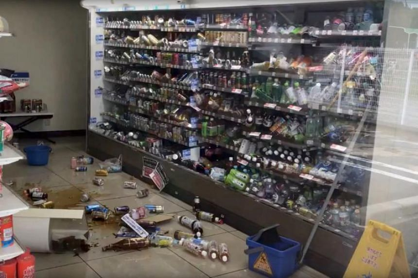 Bottled drinks are scattered on the floor of a shop after an earthquake hit Osaka, Japan on June 18, 2018.