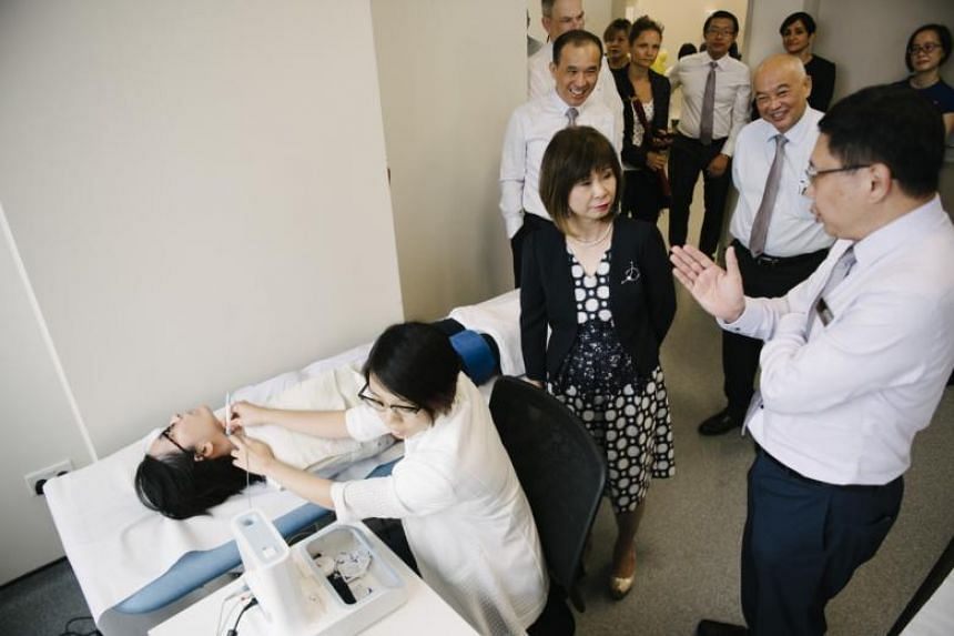 """Senior Minister of State for Health Amy Khor (second right) said the launch of the laboratories is timely as """"Singapore earnestly prepares for its rapidly ageing population in the next one to two decades""""."""