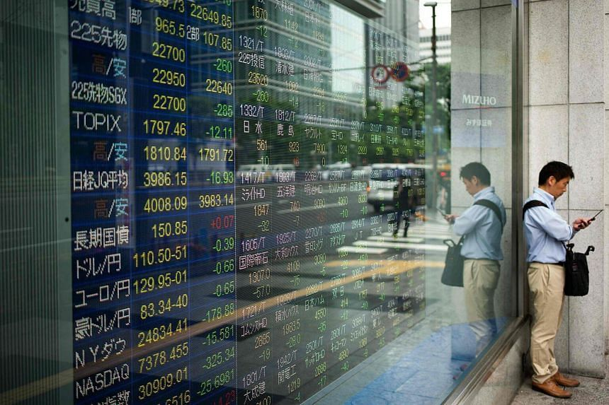 Japan's Nikkei slid 0.7 per cent as fears of growing protectionism overshadowed stronger-than-expected export data.