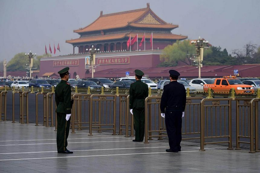 File photo showing Chinese police officers taking position near Tiananmen Square in Beijing, on March 27, 2018.