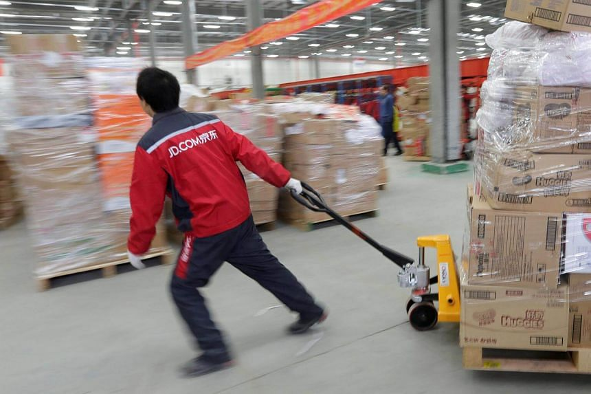 A worker moving goods at a JD.com logistic centre in Langfang, Hebei province, China.