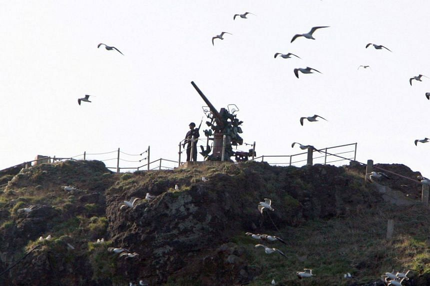 File photo showing an armed South Korean policeman standing guard on the Dokdo islands. Seoul has controlled the islets in the Sea of Japan (East Sea) since the end of Japanese colonial rule on the Korean peninsula.