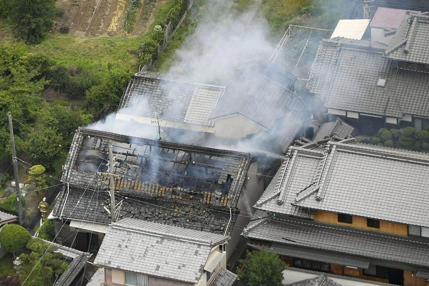 Private broadcaster TV Asahi showed firefighters responding to a blaze that broke out after the quake at a house north of Osaka city.