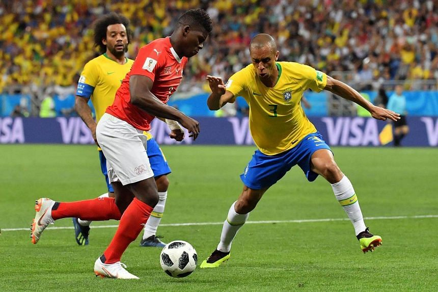 Switzerland's forward Breel Embolo (left) and Brazil's defender Miranda compete for the ball during the game.