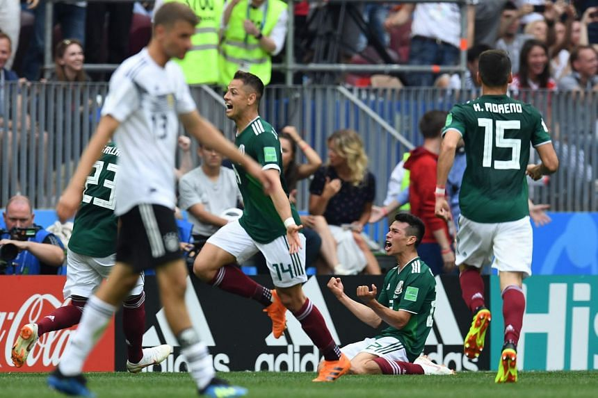 Mexico's forward Hirving Lozano kneeling to celebrate his goal against Germany in their World Cup Group F match at the Luzhniki Stadium in Moscow on June 17, 2018.