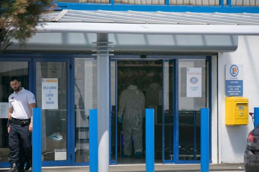 """A French forensic police officer walks into the supermarket where two people were injured when a woman shouting """"Allahu akbar"""" (God is greatest) attacked them with a boxcutter on June 17, 2018 in La Seyne-sur-Mer, southern France."""