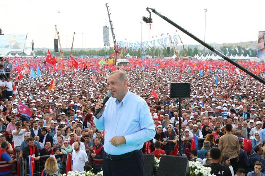 Turkey's President Recep Tayyip Erdogan, leader of the Justice and Development Party (AKP), addressing party supporters during an AKP rally in Istanbul, on June 17, 2018.