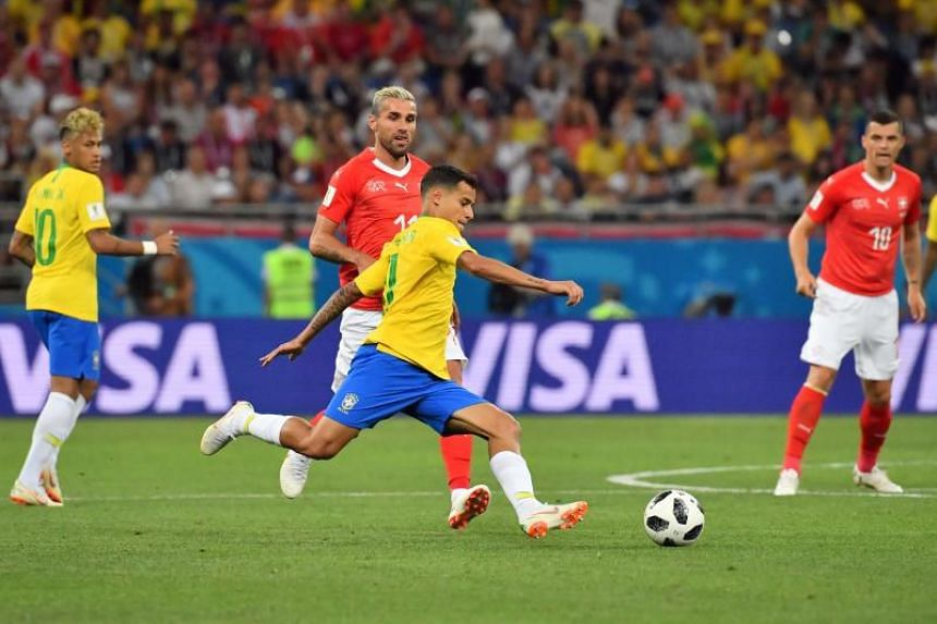 Brazil's forward Philippe Coutinho passes the ball during the Russia 2018 World Cup Group E football match between Brazil and Switzerland at the Rostov Arena in Rostov-On-Don on June 17, 2018.