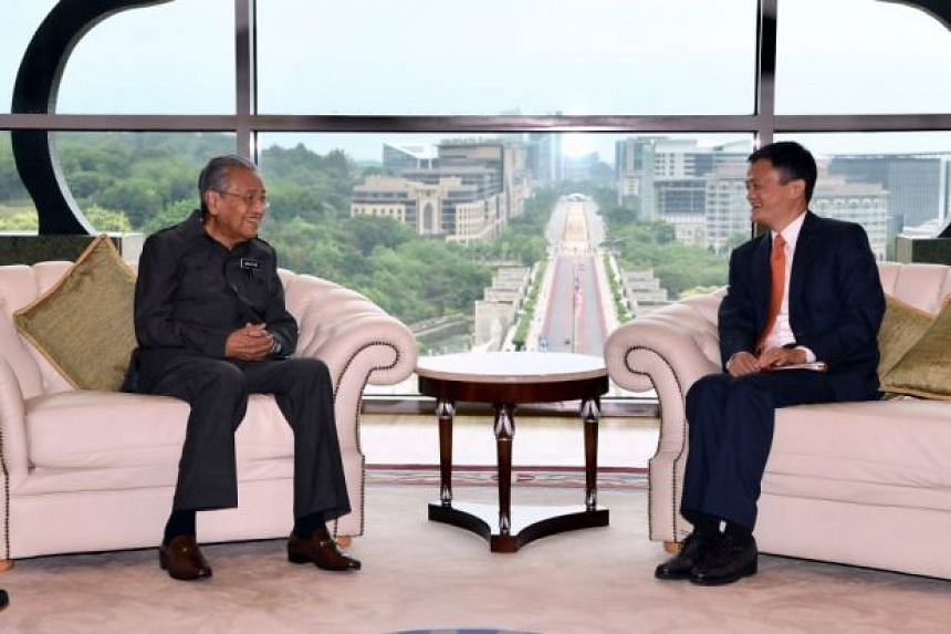 Alibaba founder and chief executive officer Jack Ma (right) with Prime Minister Mahathir Mohamad at his office in Putrajaya, on June 18, 2018.