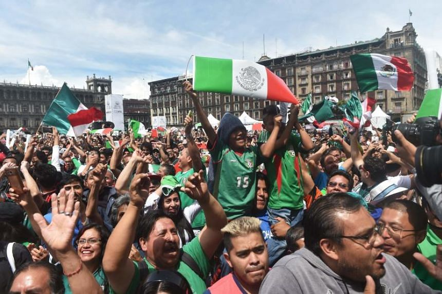Mexicans celebrate their country's World Cup goal against Germany at Zocalo Square in Mexico City.