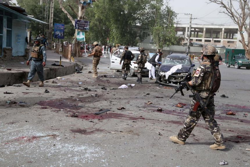 Afghan security officials inspect the scene of a suicide bombing that targeted the participants of a meeting between Taleban militants and the Governor of Nangarhar province, in Jalalabad, on June 17, 2018.