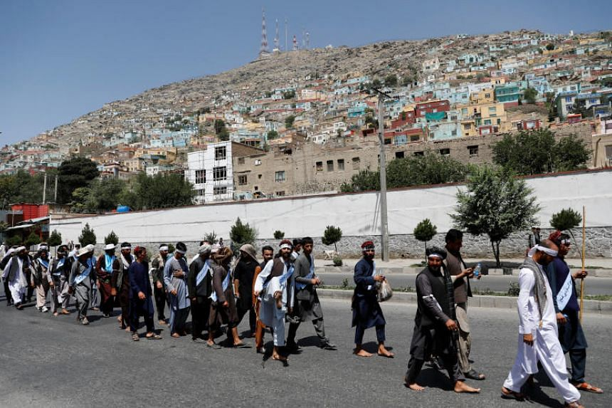 Afghan peace marchers arrive in Kabul on June 18, 2018.