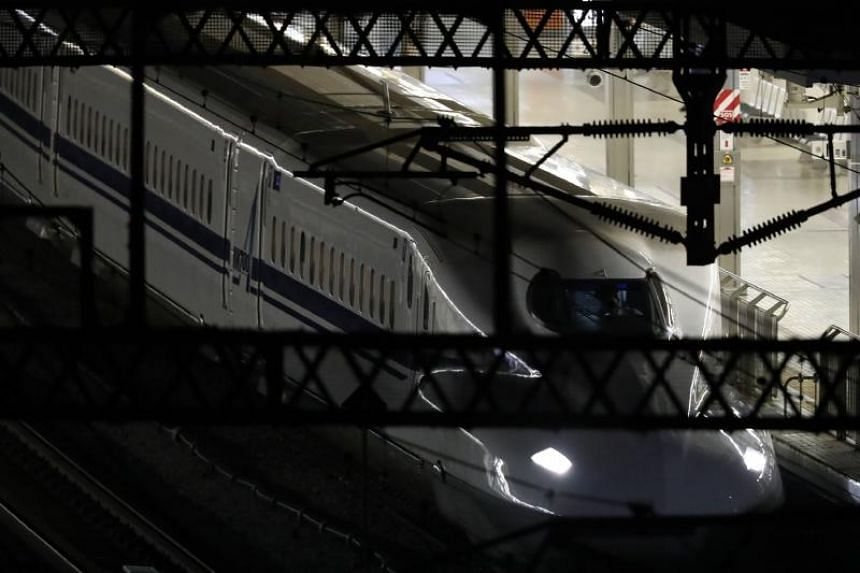 Japan's bullet train Nozomi 265 is seen after the train made a stop due to a stabbing attack at Odawara station in Odawara, Kanagawa prefecture, on June 10, 2018.