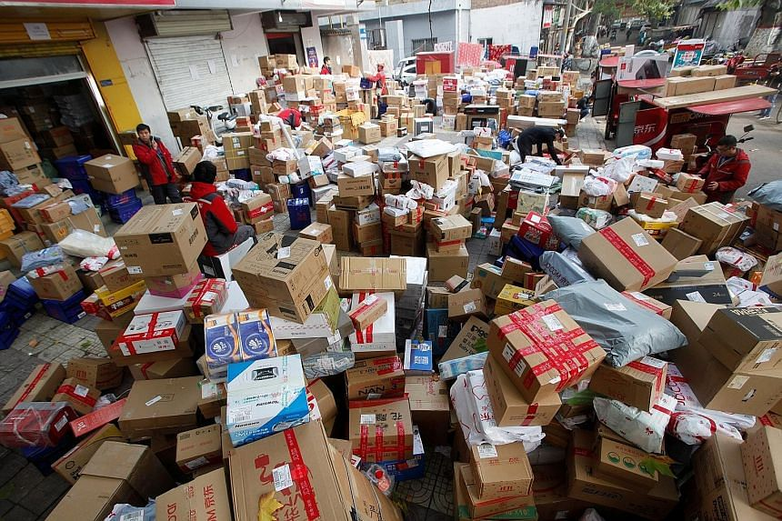 Workers sorting boxes and parcels at a JD.com logistics station in Xi'an, China. Google's investment in the Chinese e-commerce powerhouse is part of a broader partnership that will include the promotion of JD.com products on Google's shopping service
