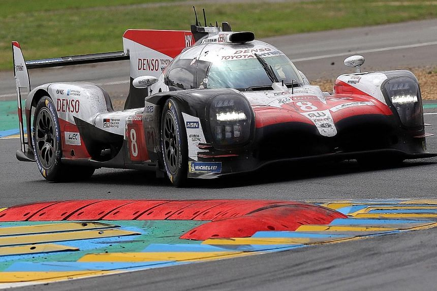 """The Toyota TS050 Hybrid that Fernando Alonso drove in Sunday's Le Mans 24 Hours race. He finds a Triple Crown bid """"very tempting""""."""