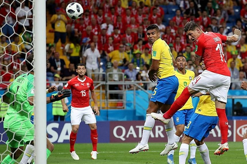 Steven Zuber outleaping Miranda (unsighted) to head home Switzerland's equaliser against Brazil, who felt that Zuber had pushed their player.