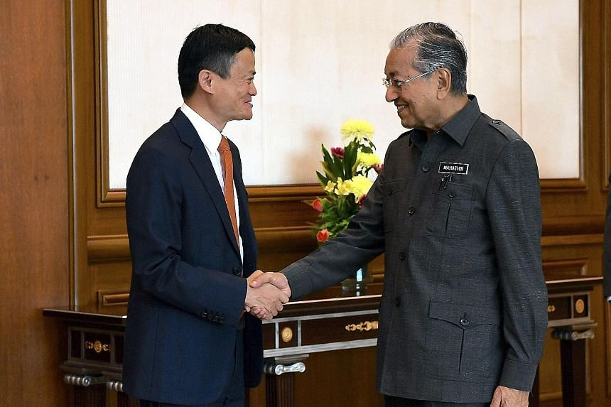 Alibaba Group founder Jack Ma meeting Malaysian Prime Minister Mahathir Mohamad in Putrajaya yesterday. Part of Mr Ma's interest in Malaysia is the Digital Free Trade Zone launched last November.