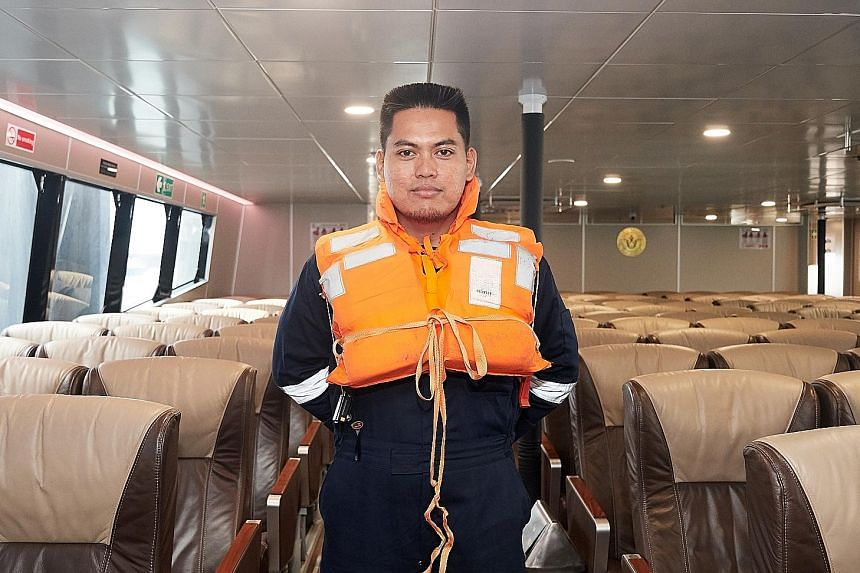 Majestic Dream ferry chief engineer Abdurrahman Basuni, 35, wearing an older string-type life jacket (above) and the new buckle-type life jacket, which is in use on his vessel.