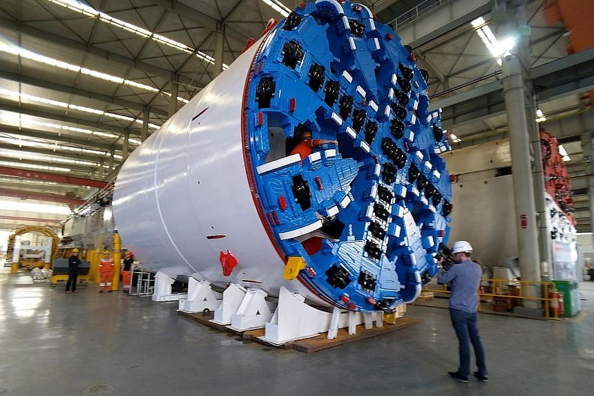 A 6.7m-diameter tunnel boring machine that will be shipped to Singapore, for the North East Line Extension project, being assembled in a factory in Zhengzhou, Henan province.