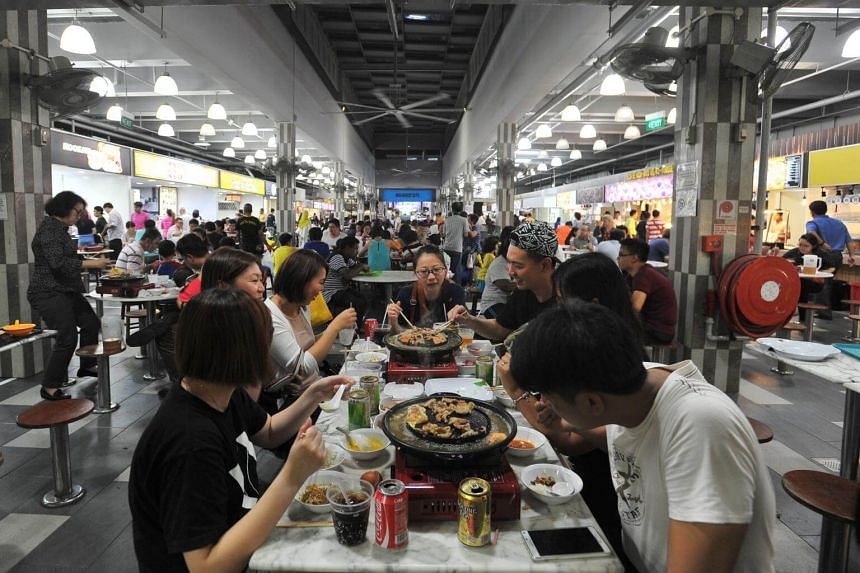 File photo showing a dinner crowd at a food centre in Sengkang.