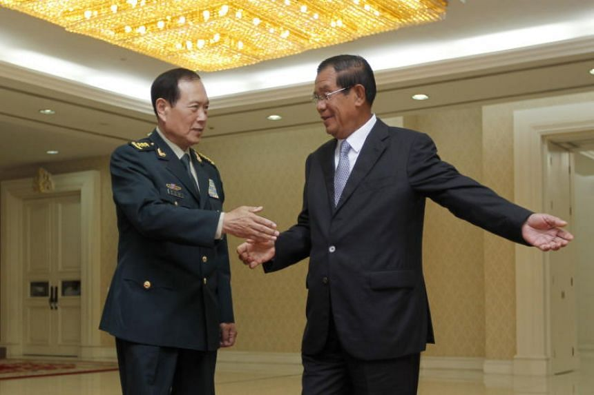 Chinese defence minister Wei Fenghe (left) with Cambodian Prime Minister Hun Sen at the Peace Palace in Phnom Penh on June 18, 2018.
