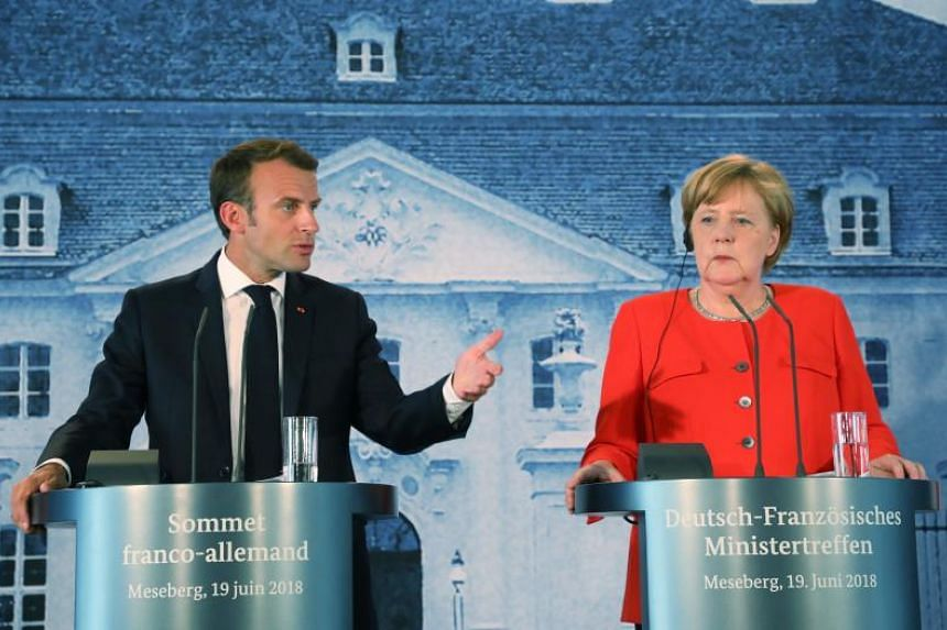 French President Emmanuel Macron and German Chancellor Angela Merkel at a press conference after their bilateral talks at the Meseberg Palace in Germany on June 19, 2018.