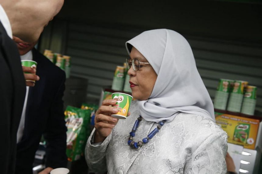 President Halimah Yacob made and drank the first official cup of Milo Gao Kosong at Plaza Singapura on June 19, 2018.