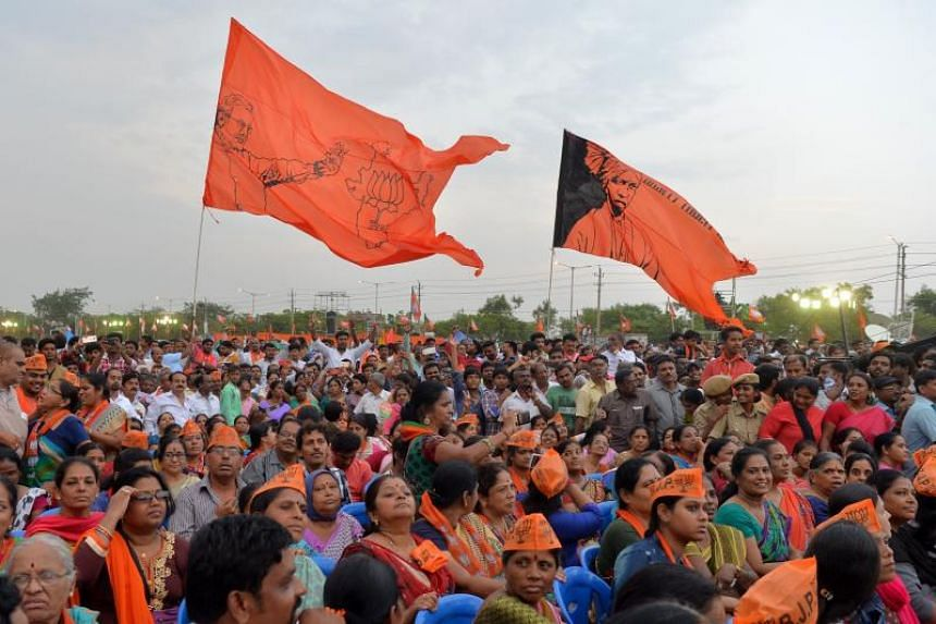Indian Bharatiya Janata Party (BJP) supporters take part in an election campaign rally held in Bangalore, on May 3, 2018.