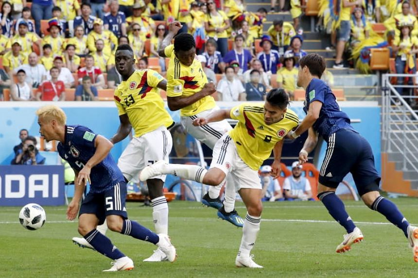 Radamel Falcao (centre) of Colombia in action during their Fifa World Cup 2018 group H preliminary round soccer match against Japan in Saransk, Russia, on June 19, 2018.
