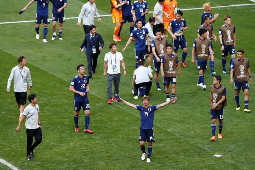 Japan players celebrate after the World Cup Group H match against Colombia at the Mordovia Arena in Saransk, Russia, on June 19, 2018.