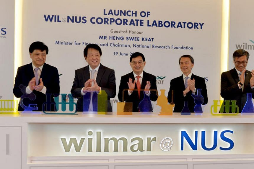 (From left) Professor Chua Nam-Hai, Mr Kuok Khoon Hong, Minister Heng Swee Keat, Mr Hsieh Fu Hua and Professor Tan Eng Chye during the launch of the new WIL@NUSCorporate Laboratory.