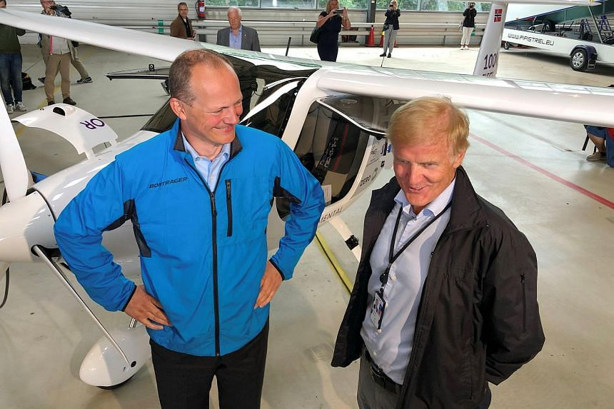 Norwegian Transport Minister Ketil Solvik-Olsen and head of the Avinor Dag Falk-Petersen stand next to a two-seat electric plane made by Slovenian company Pipistrel at Oslo Airport, Norway, on June 18, 2018.