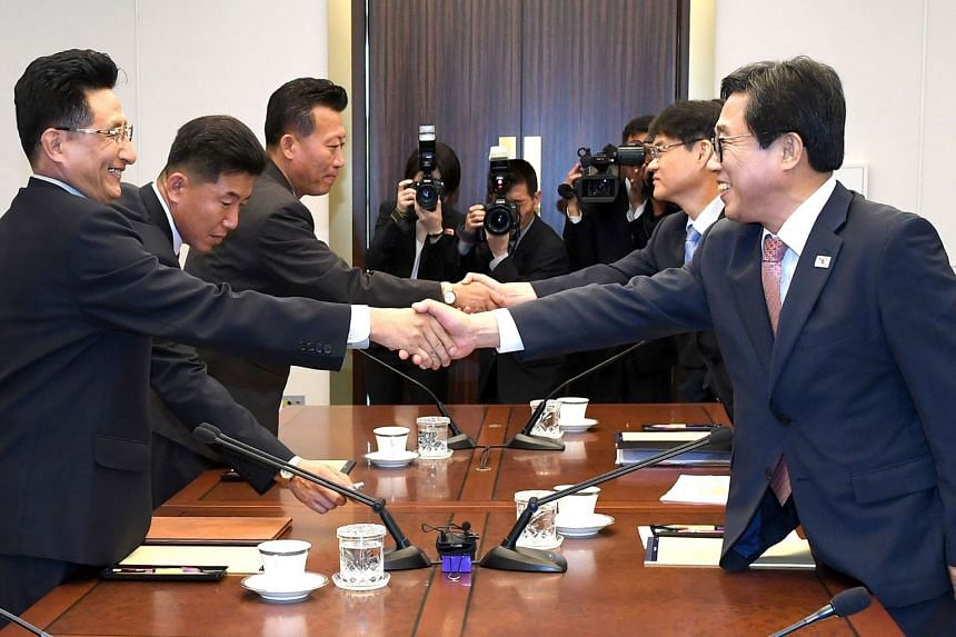 """South Korea's chief delegate Jeon Choong Ryul (right) with North Korean counterpart Won Kil U during talks at Panmunjom yesterday on forming unified teams for the Asian Games. Seoul has said sanctions on Pyongyang could be eased once it takes """"su"""