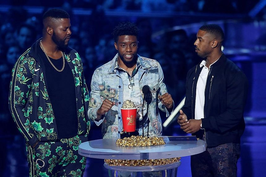 Actors (from left) Winston Duke, Chadwick Boseman and Michael B. Jordan accept the Best Movie award for Black Panther at this year's MTV Movie & TV Awards.
