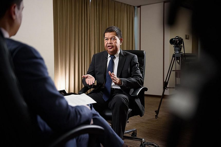 Philippine central bank governor Nestor Espenilla giving an interview in Tokyo yesterday. He has said the peso's movements have been market-driven, and the currency continues to draw support from the country's healthy macroeconomic fundamentals. But