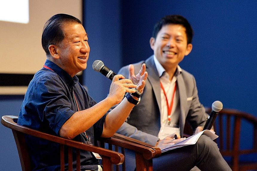 Mr Gerard Ee, executive director of Beyond Social Services, with IPS research fellow Justin Lee as the moderator, during the question-and-answer session at the Community Forum yesterday. Mr Ee, who was the keynote speaker, touched on the theme of the