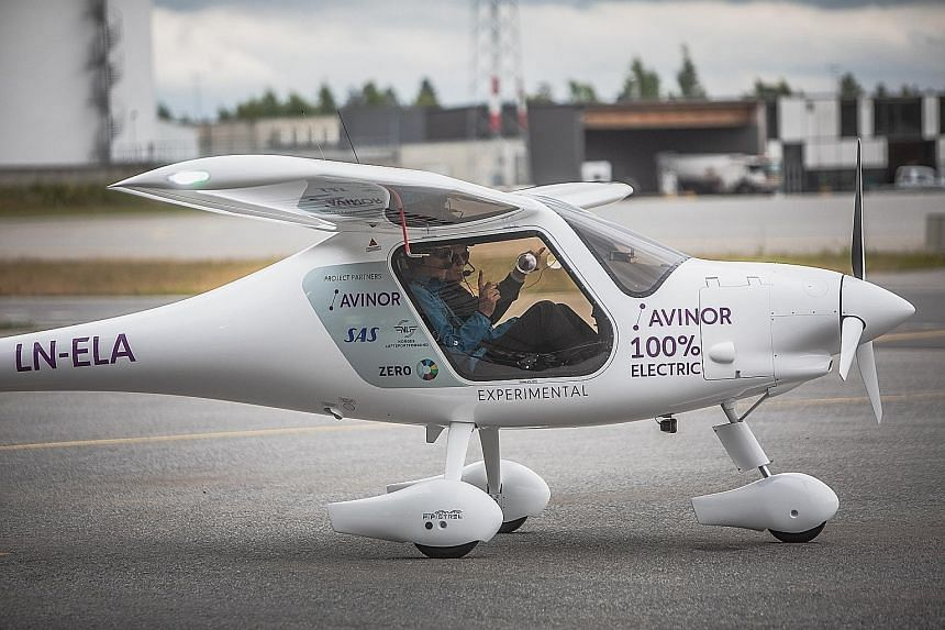 Norwegian Transport Minister Ketil Solvik-Olsen (left) and pilot Dag Falk-Petersen, head of state-run Avinor, preparing to take off in an Alpha Electro G2 electric two-seater plane for its inaugural flight on Monday.