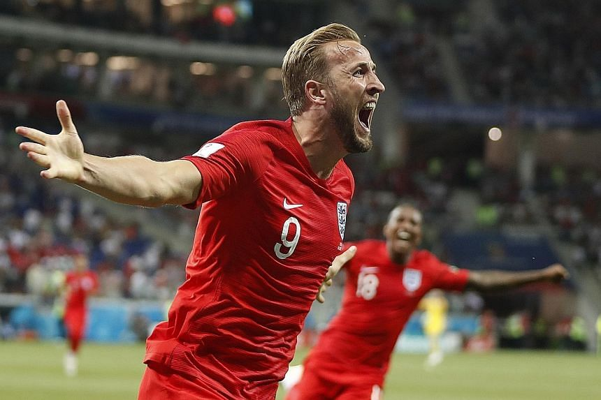 England captain Harry Kane celebrating after heading in the winning goal from another set piece against Tunisia, having also opened the scoring from a corner. It was the first time the Three Lions managed to win their opening World Cup game since bea