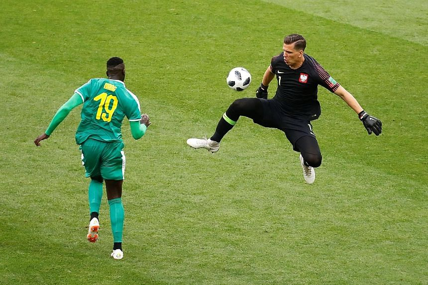 M'Baye Niang scoring Senegal's second goal past Poland's goalkeeper Wojciech Szczesny in the 60th minute of their World Cup Group H match at the Spartak Stadium in Moscow yesterday. Senegal had led by a Thiago Cionek own goal in the 37th minute. Pola