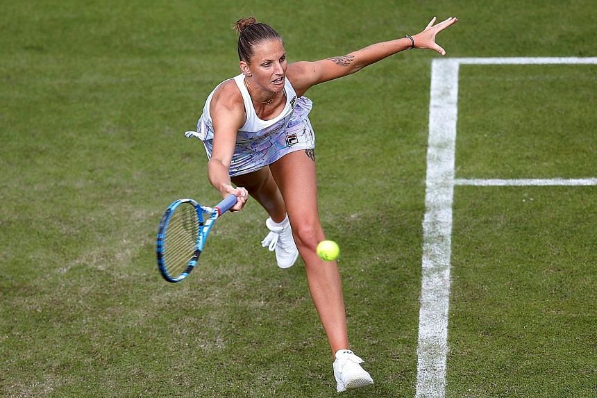 Czech Karolina Pliskova (above) in action during her round of 32 match against Slovakia's Magdalena Rybarikova (right) on Monday. Rybarikova won 6-2, 6-3, claiming the victory in just over an hour.