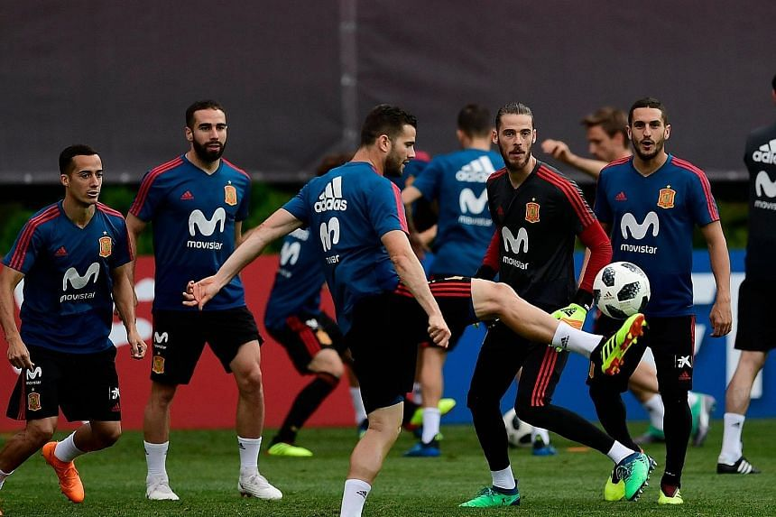 Spain defender Nacho Fernandez, who scored what could have been the winner until Cristiano Ronaldo struck for Portugal in their 3-3 draw last Friday, controlling the ball as goalkeeper David de Gea and other team-mates watch during training at the Kr