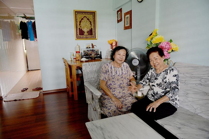 Madam Tan Gek Bee (far left, with her neighbour Soh Ah Tung) moved back to MacPherson Lane (above) in 2004 as she missed the area. The women now meet at Madam Tan's flat up to four times a week to chat.