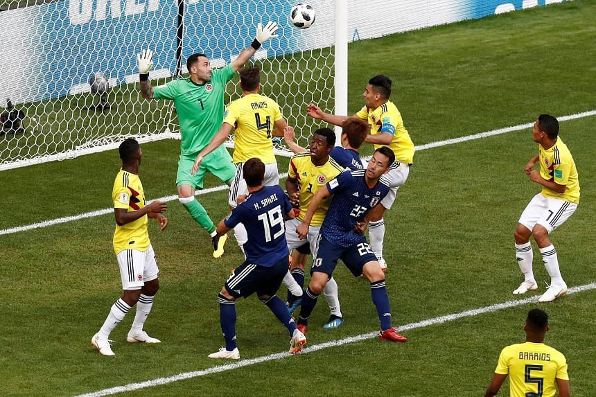 Japan's Yuya Osako (third from right) scoring their second goal, which sealed a 2-1 win over Colombia in their World Cup Group H match at the Mordovia Arena in Saransk yesterday.