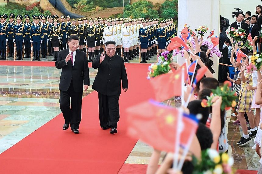 Chinese President Xi Jinping with North Korean leader Kim Jong Un in Beijing yesterday. During their meeting at the Great Hall of the People, Mr Xi said he was pleased with the positive results of Mr Kim's summit with US President Donald Trump in Sin