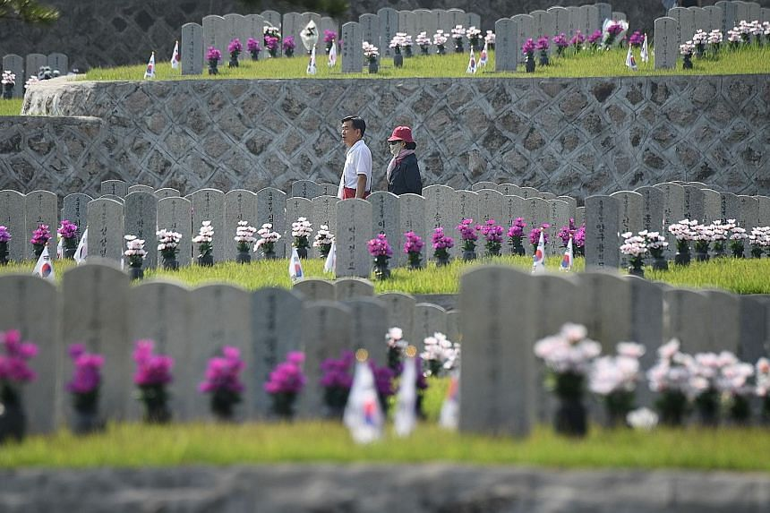 The gravestones of South Korean soldiers killed in the 1950-1953 Korean War at the National Cemetery in Seoul. The US promise to alter the armistice raises questions as it is not something it could do on its own.