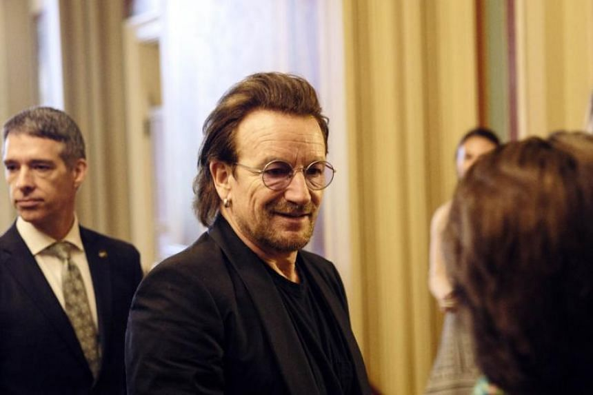 Singer Bono of U2 greets people at the US Capitol, on June 19, 2018.